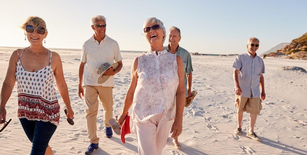 Book A Ride Passengers Walking Orewa Beach